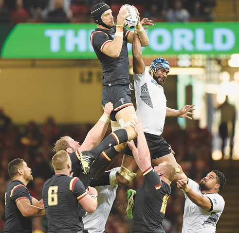 CARDIFF: Luke Charteris of Wales wins a lineout during the World Cup match against Fiji at the Millennium Stadium.—Reuters