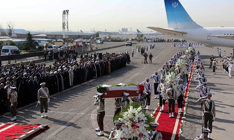 The Iranian honour guard carries the caskets of Iranian pilgrims killed in the 2015 Mina stampede during a repatriation ceremony upon their arrival at Tehran's Mehrabad airport. ─ AFP/File
