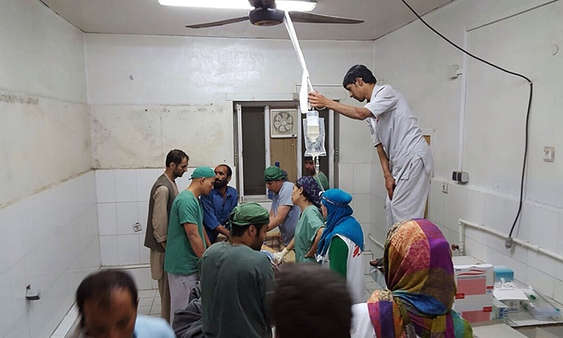 Afghan MSF surgeons work in an undamaged part of the MSF hospital in Kunduz after the operating theatres were destroyed in an air strike. — AFP