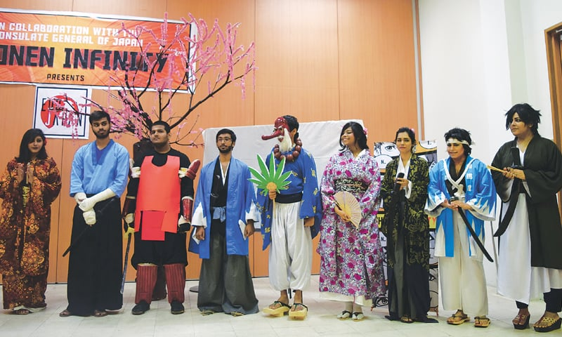 Posing as characters from the Edo era, a group of performers at the Japanese consulate on Saturday.—Photo by writer