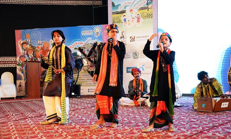 Young artists perform during the Children's Literature Festival at Lok Virsa. ─ Online