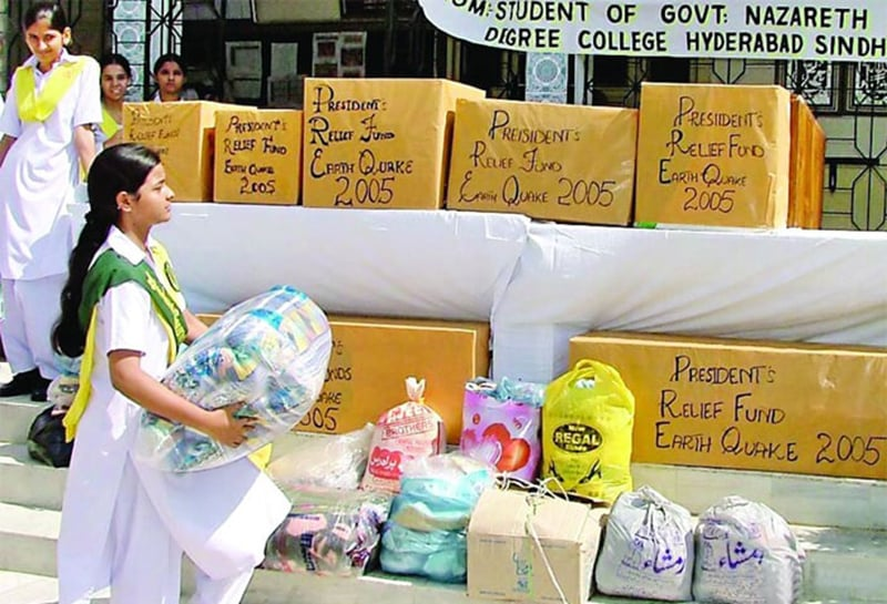 Students of the Government Nazareth Girls College in Hyderabad collect relief goods for quake victims. —Online