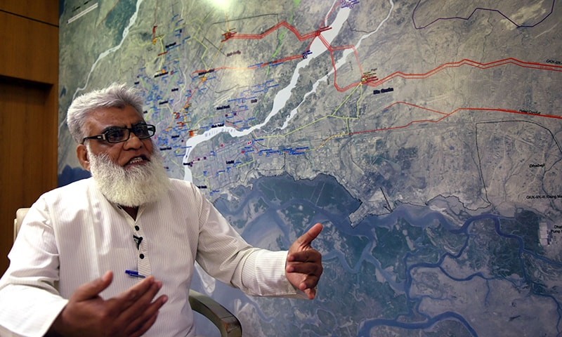 In this photograph taken on August 20, 2015, deputy managing director of the Karachi Water and Sewerage Board, Iftikhar Ahmed Khan, gestures as he speaks during an interview at his office in Karachi. — AFP