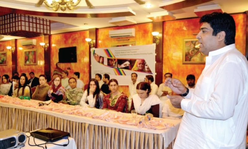 Qamar Nasim, head of Blue Veins, addresses a consultation meeting organised by Trans Action Forum in Peshawar on Monday to create awareness about problems faced by transvestites. — White Star