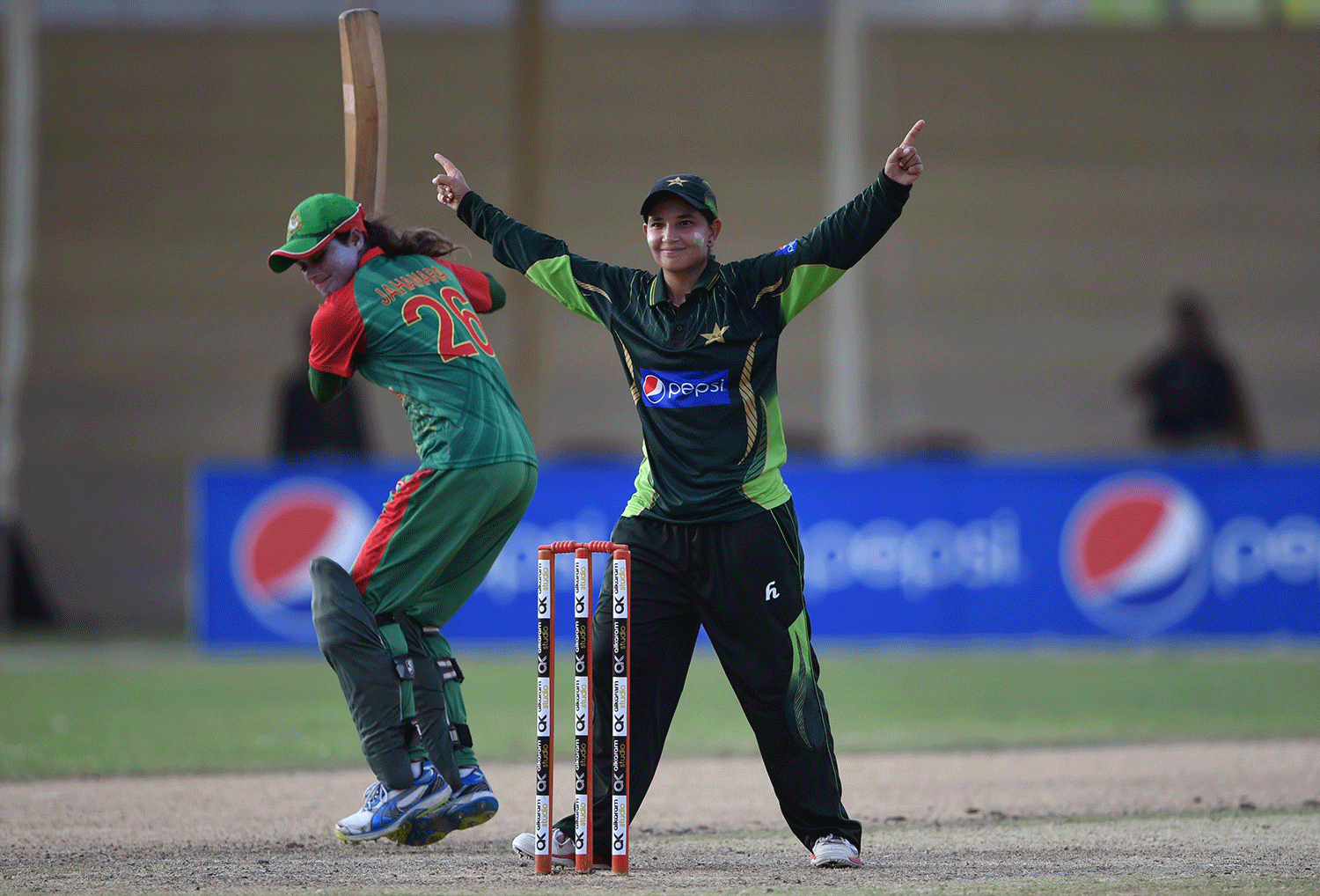 Pakistan's Anam Amin (R) celebrates after taking one of her four wickets. — AFP