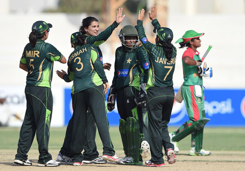 Pakistan celebrate the dismissal of Bangladesh's Fargana Hoque (R). — AFP