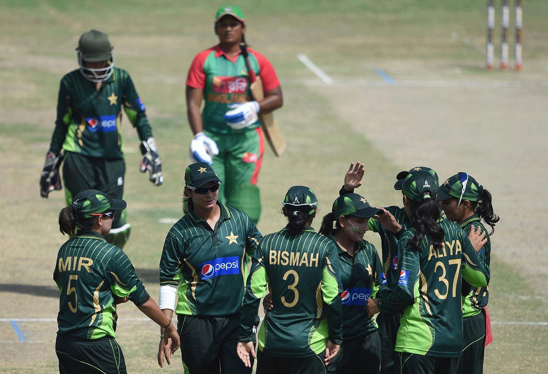 Pakistan celebrate the dismissal of Bangladesh's Ayesha Rehman (C-back). — AFP