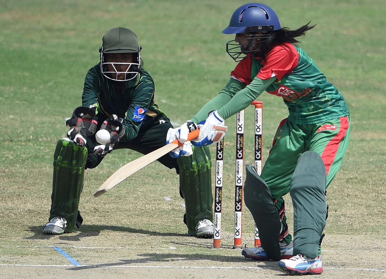 Bangladesh's Nigar Sultana Joty (R) plays a shot as Pakistani wicketkeeper Rabiya Shah looks on. — AFP