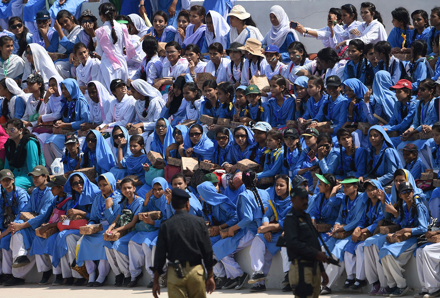 Pakistani students watch the second and final women's One Day International (ODI) cricket match between Pakistan and Bangladesh at the Southend Club in Karachi on October 6, 2015. — AFP