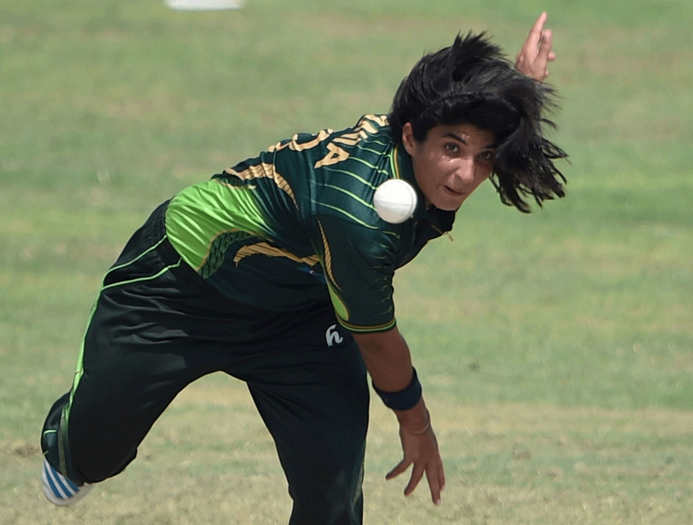 Pakistan bowler Sania Khan delivers the ball. — AFP