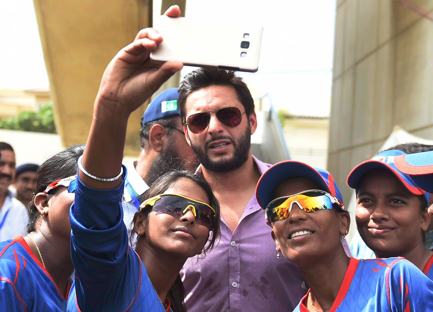"Members of the Bangladesh team take a selfie with Pakistani cricketer Shahid Afridi (C) in Karachi on October 5, 2015. Pakistani all-rounder Shahid Afridi criticised Australia's decision to call off their Bangladesh tour citing terrorism fears, saying that while security was paramount tours should ""not be cancelled over minor issues"". Australia scrapped its two-Test tour of Bangladesh last week after official warnings militants may attack Western interests. — AFP"