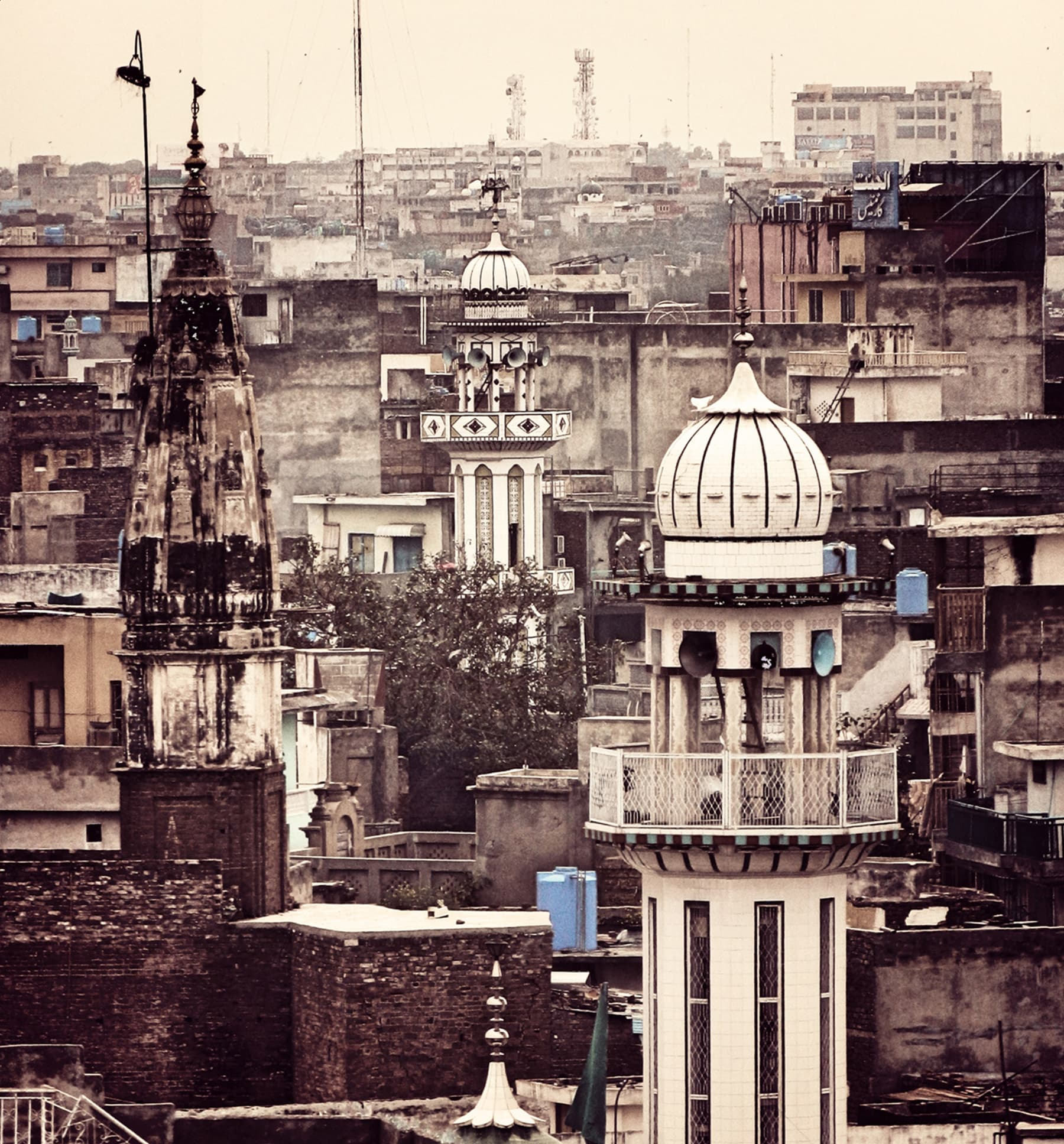 Mandir spire juxtaposed with Mosque Minar in the Bhabra bazaar neighbourhood of Old Rawalpindi.—Muhammad Bin Naveed