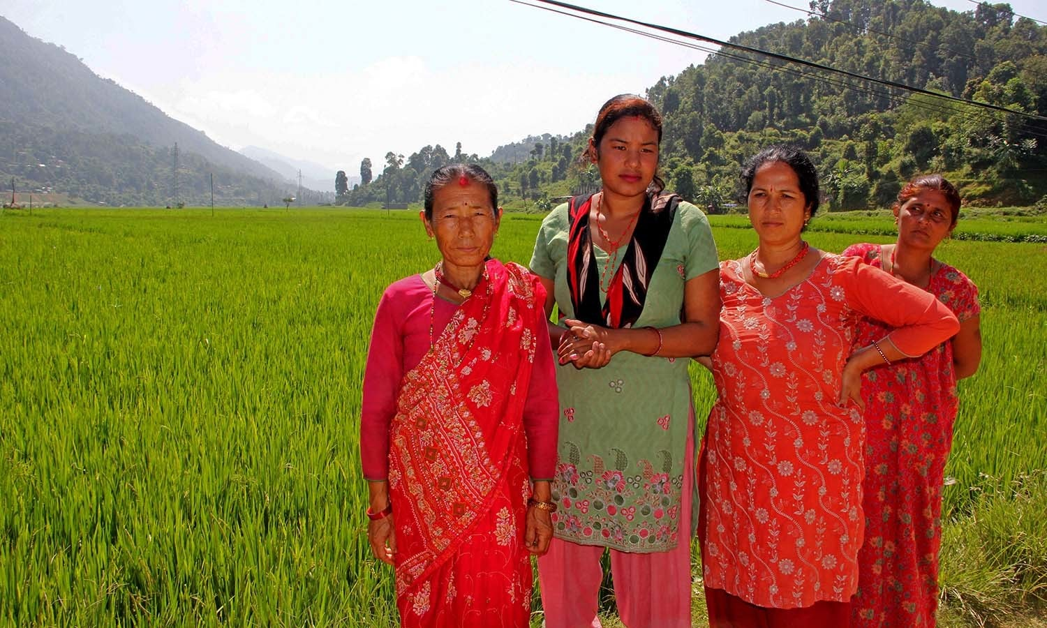 Women farmers stand in a rice field grown with the SRI method in a climate-smart village in Nepal. — Photo by author