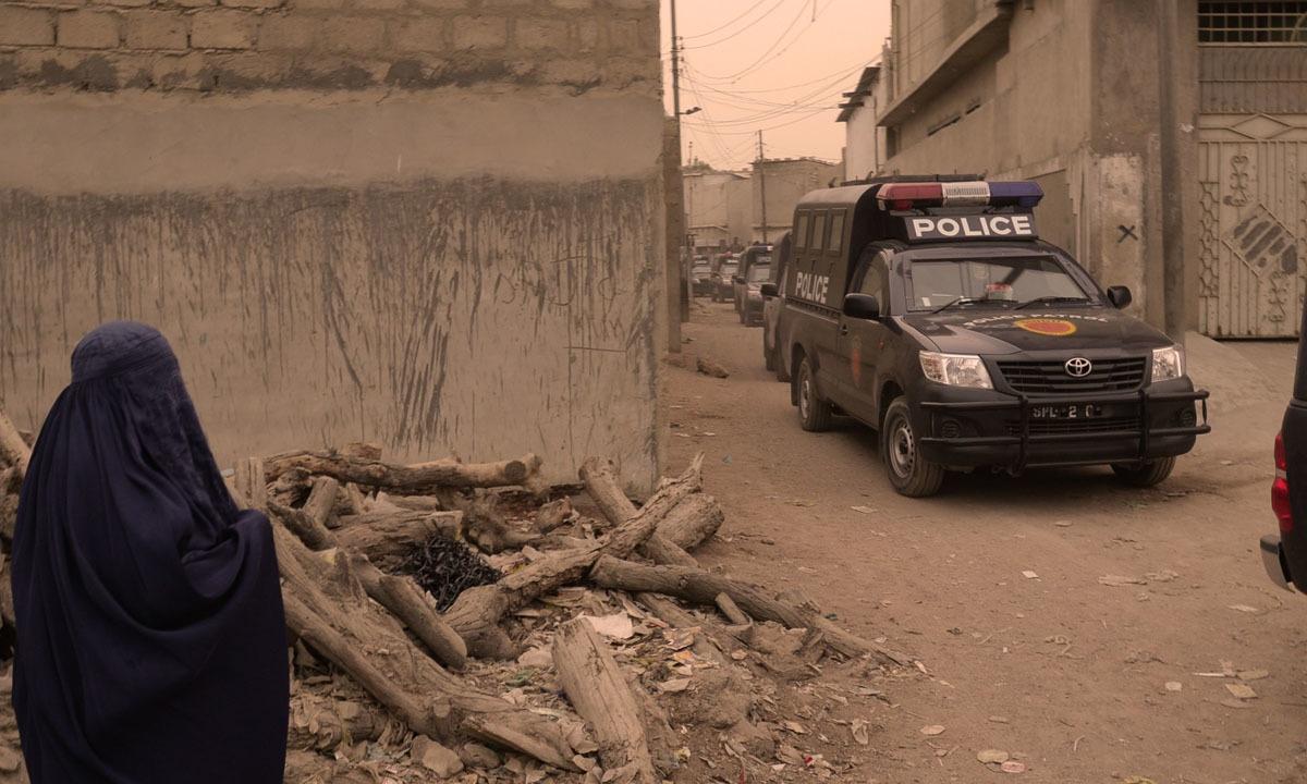 Police vehicles enter the Sohrab Goth area for a raid | Faysal Mujeeb, White Star