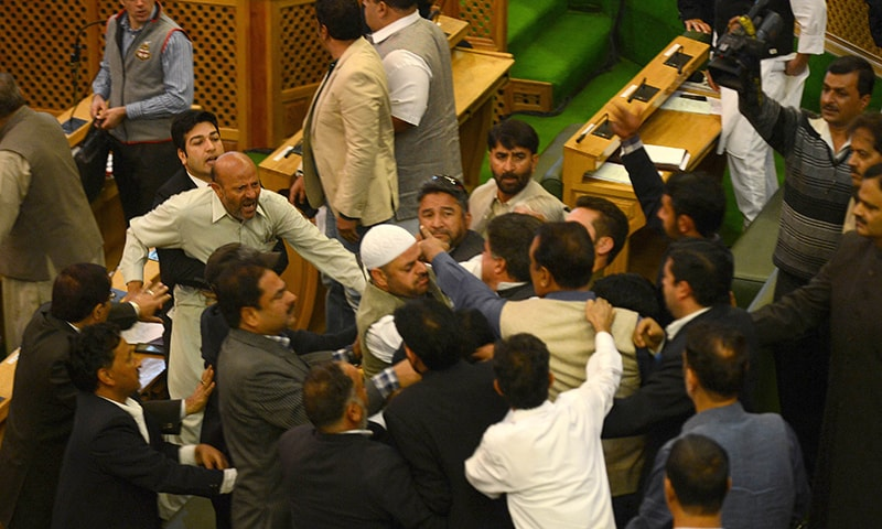 Independent lawmaker, Engineer Rashid (CL) shouts after being thrashed by Bhartiya Janta Party (BJP) legislators in the legislative assembly in Srinagar on October 8, 2015.  — AFP