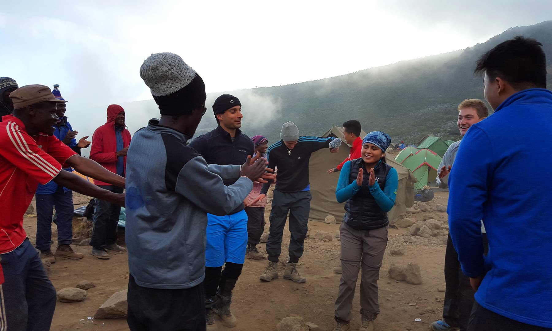 Campsite song and dance with the porters and the rest of the crew.