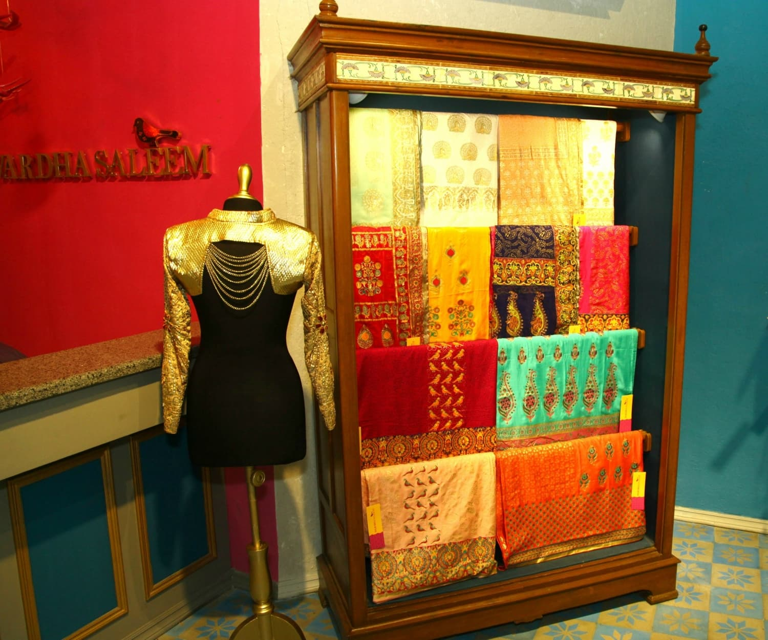Unstitched fabric is displayed in a vintage cupboard that came from Wardha's ancestral home in Hyderabad