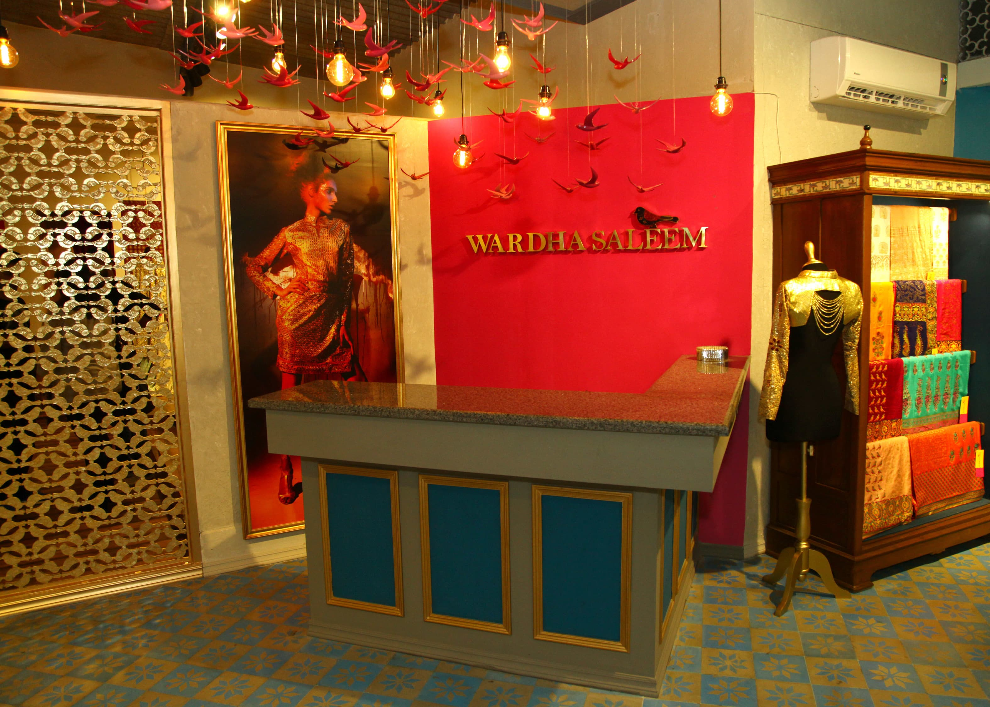 Wardha's signature birds hover over the reception of her new store