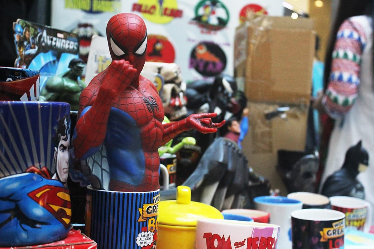 A Spiderman piggy bank at a stall selling merchandise. — Photo: Azmeena Alidina