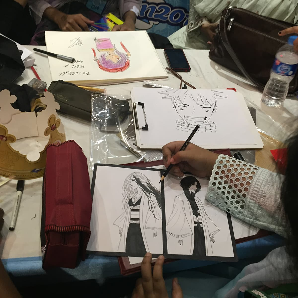 Participants taking part in fanart competition at the event. Photo: Ema Anis