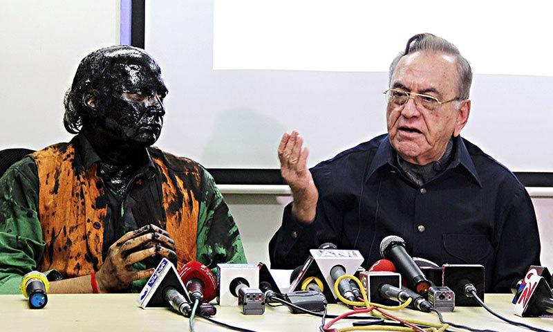 Sudheendra Kulkarni looks on as former Pakistani foreign minister Khurshid Mahmud Kasuri speaks to media in Mumbai ─ AFP