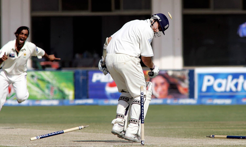 A Shoaib Akhtar thunderbolt goes through Ashley Giles' defence. —AFP