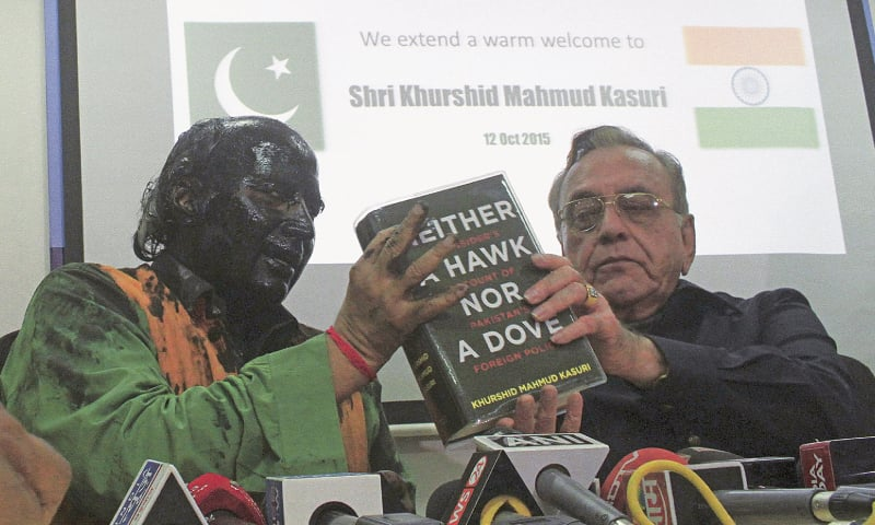 MUMBAI: Sudheendra Kulkarni, chairman of the Observer Research Foundation, Mumbai, his face smeared with black ink, holds a copy of the book by former foreign minister Khurshid Mahmud Kasuri 'Neither a Hawk Nor a Dove' during a news conference here on Monday.—Reuters
