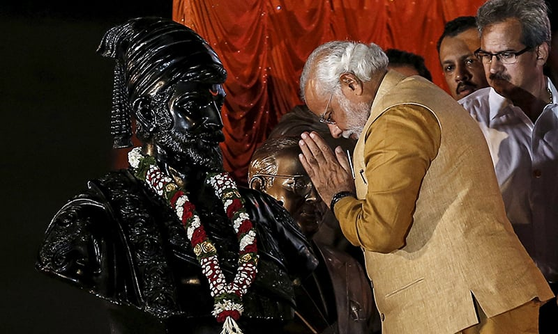 Hindu nationalist PM Narendra Modi gestures at the statue of Chhatrapati Shivaji, during an election campaign rally in Mumbai. — Reuters