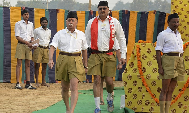 Bhagwat (3rd L), chief of RSS, walks after addressing volunteers during a training camp in Agra, India. — Reuters