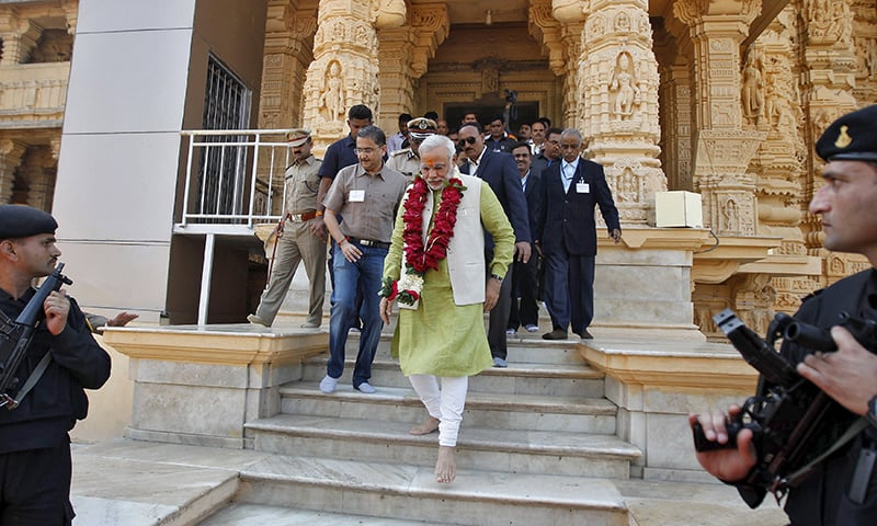 Indian PM Modi walks inside the complex of a Hindu temple at Somnath in the western Indian state of Gujarat. — Reuters