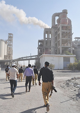 POLICE along with EPA officials visit the cement factory to seal it off on Tuesday.—Dawn