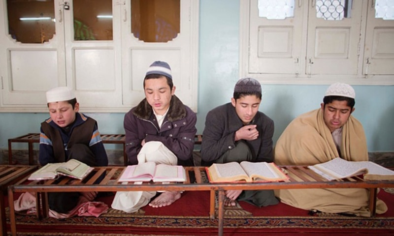Students of the Jamia Gasmia, a militant religious school in Dhodhdr. — Photo courtesy: The Guardian