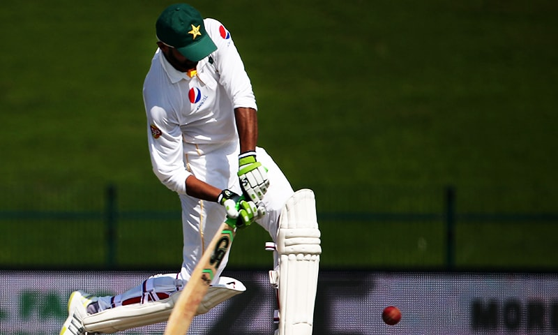 Shoaib Malik plays a shot during the second day's play of the first Test match between Pakistan and England in Abu Dhabi on October 14, 2015. — AFP