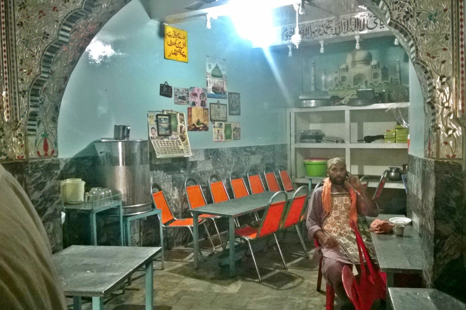 The interior of Taj Mahal sweets is dotted with pictures of shrines