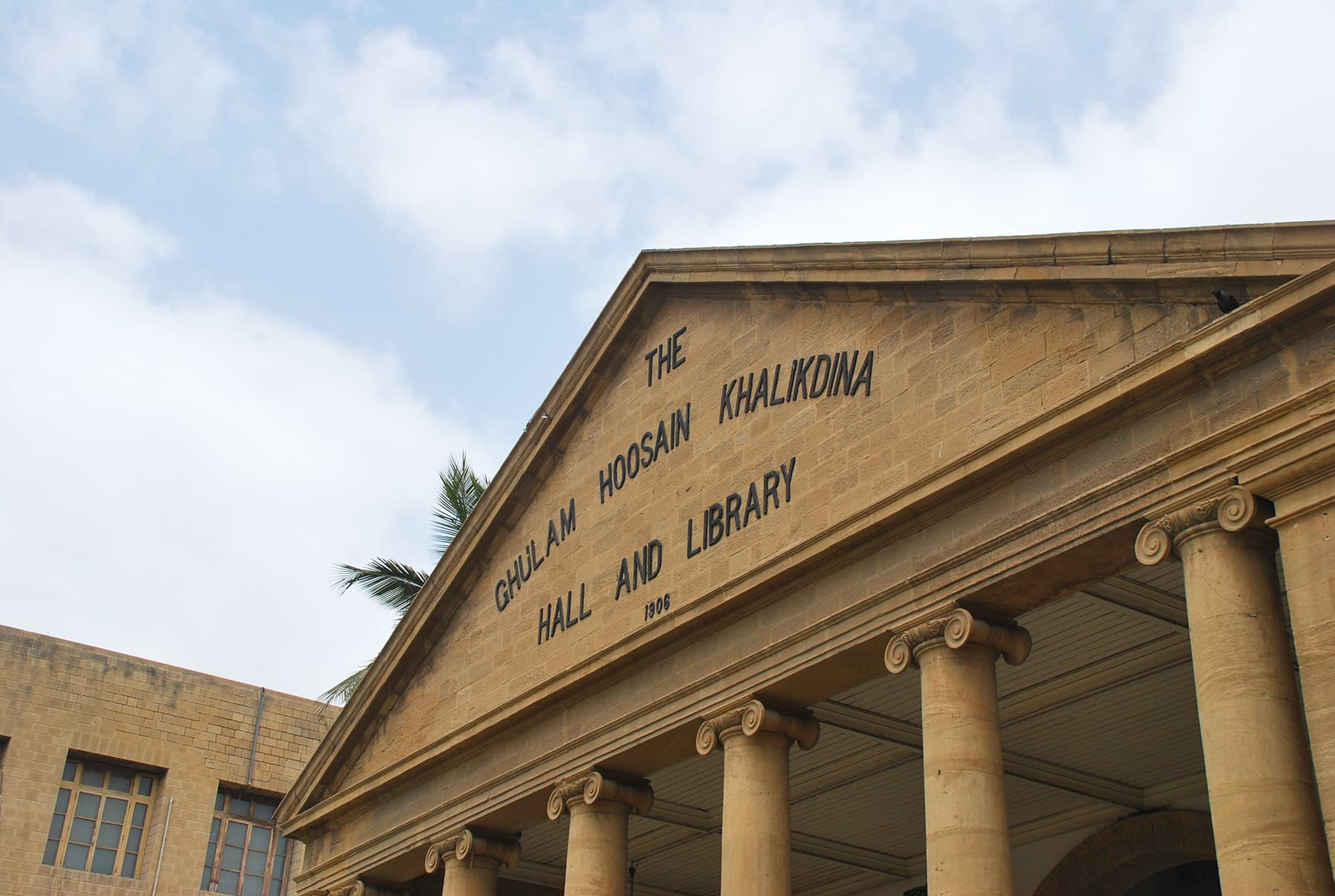 With its unique setting of pillars and pediment Khaliq Deena Hall catches your eye from a distance.