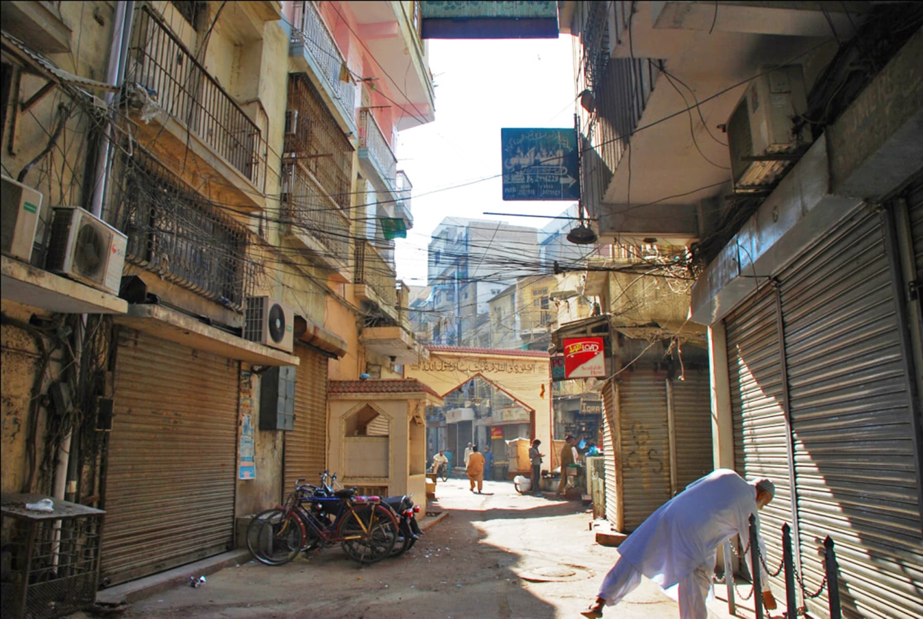 A shopkeeper opens his shop in the vicinity of Wazir Mansion.
