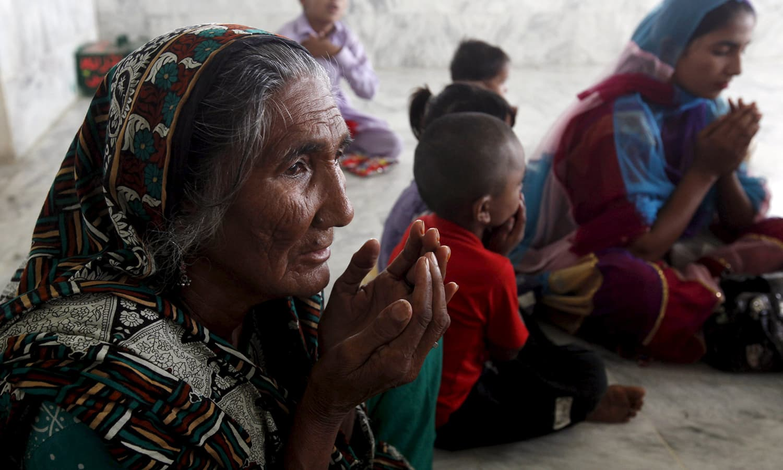 Women and children pray at the shrine of Hasan-al-Maroof Sultan Manghopir. —Reuters