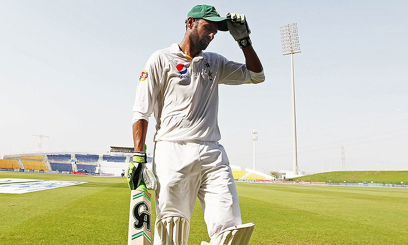 Shoaib Malik as he walks off the pitch after being knocked out in a Test match. — AFP/File