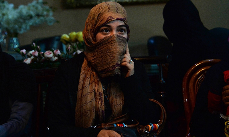 In this photograph taken on October 10, 2015, young Afghan woman Marwa, who has been displaced from the northern Afghan city of Kunduz during clashes between Afghan security forces and Taliban insurgents, speaks as she gathers with others at a temporary shelter donated by a businessman at a hotel in Kabul. —AFP