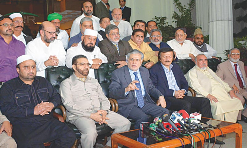 Finance Minister Ishaq Dar along with representatives of traders and FBR  officials in Islamabad on October 14. / —PID