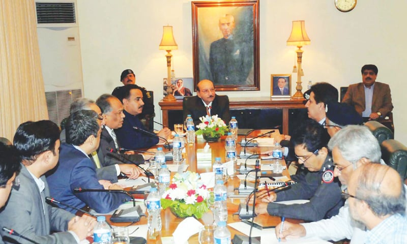 SINDH Chief Minister Syed Qaim Ali Shah presides over a meeting held on Monday to discuss ways to improve traffic management in Karachi.—PPI
