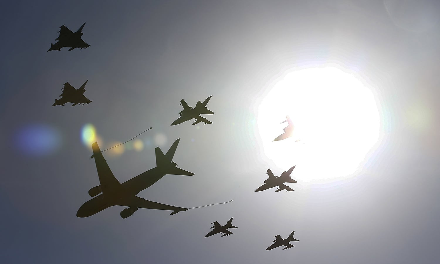 Military planes fly in formation during a Nato military exercise at the Birgi Nato Airbase in Trapani, Italy. — Reuters