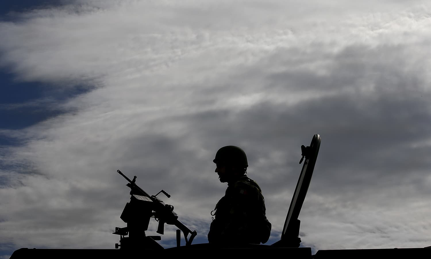 An Italian soldier is silhouetted during a Nato military exercise at the Birgi Nato Airbase in Trapani, Italy. — Reuters