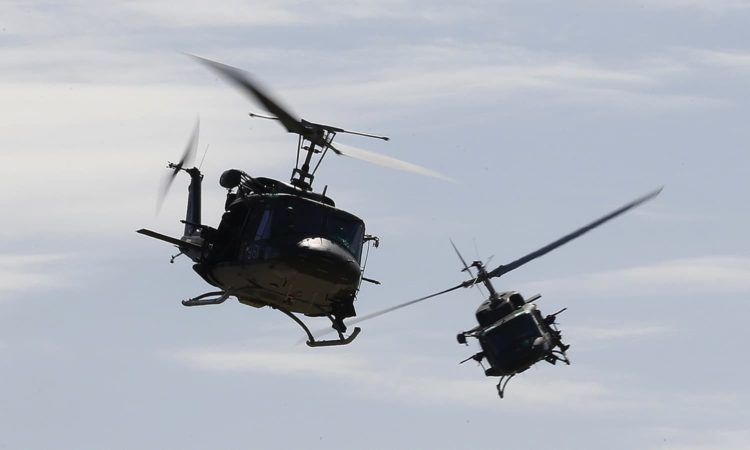 Helicopters fly during a Nato military exercise at the Birgi Nato airbase in Trapani, Italy. — Reuters
