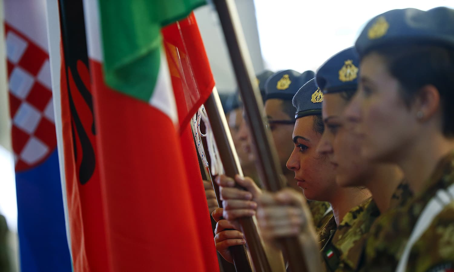 Italian soldiers hold flags during a Nato military exercise at the Birgi Nato airbase in Trapani, Italy. — Reuters
