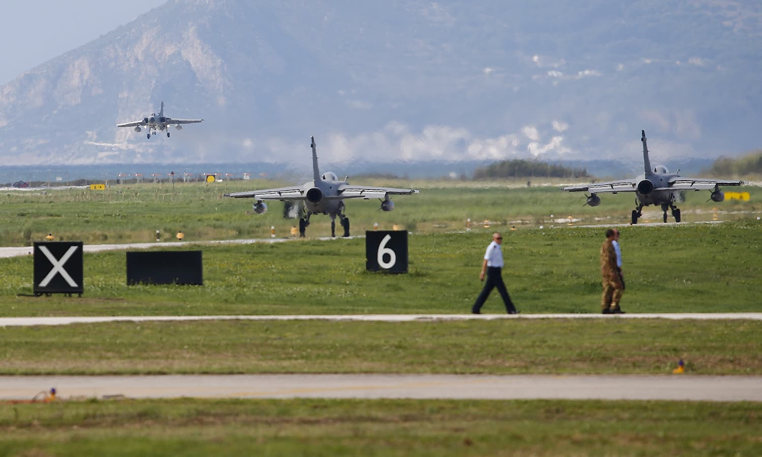 A military plane lands during a Nato military exercise at the Birgi Nato Airbase in Trapani, Italy. — Reuters