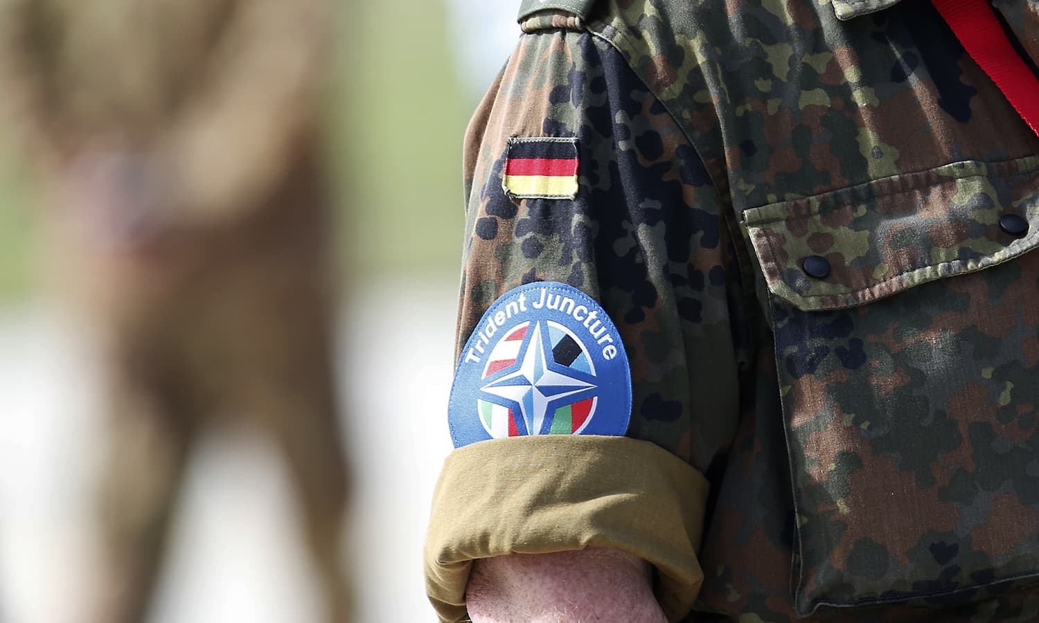 A Nato soldier wears a logo during the opening ceremony of Nato Trident Juncture exercise 2015, in Trapani, Italy. — AP
