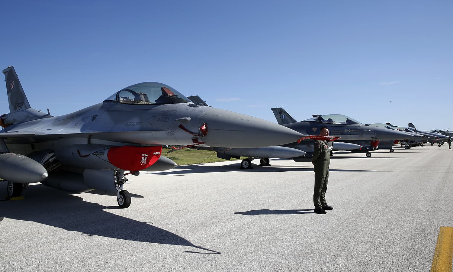 An F-16 jet fighter, foreground, is parked on the tarmac during the opening ceremony of Nato Trident Juncture exercise 2015, in Trapani, Italy. — AP