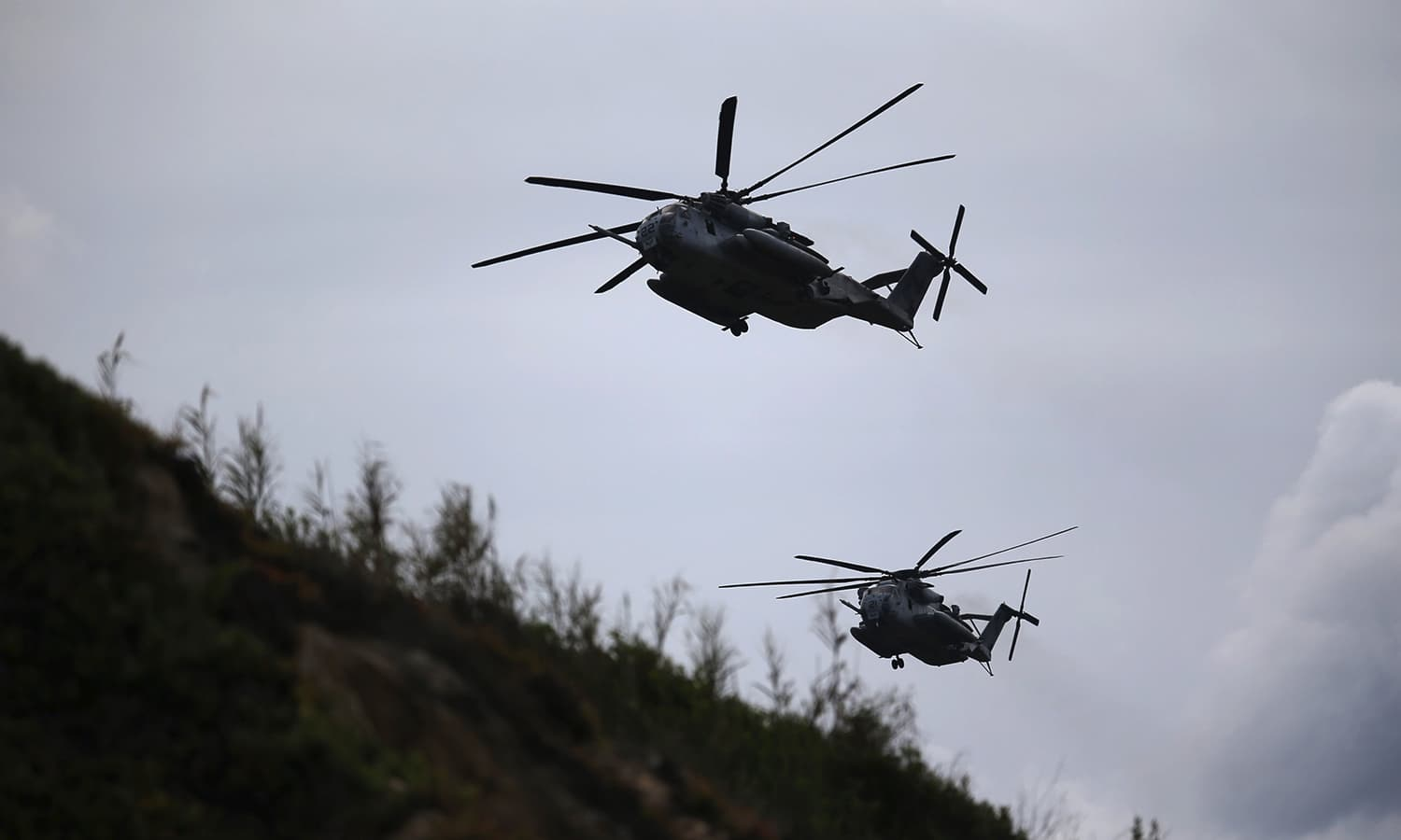 Helicopters fly during a Nato military exercise at Raposa beach, near Setubal, Portugal. — Reuters