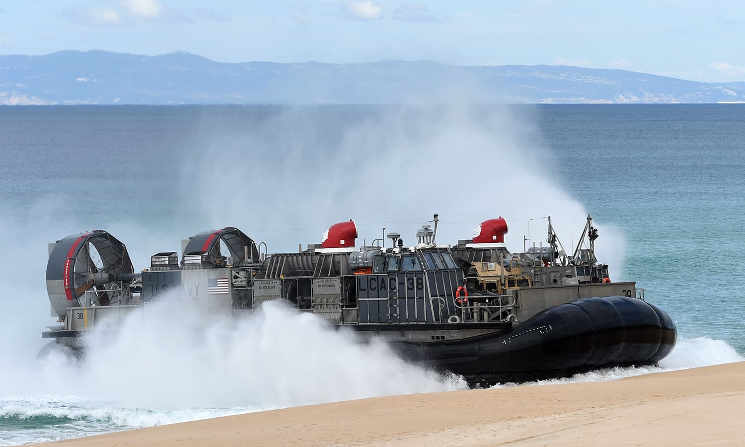A US navy hovercraft lands on a beach after being deployes by the USS Arlington amphibious transport dock during the Nato's Trident Juncture exercise — AFP
